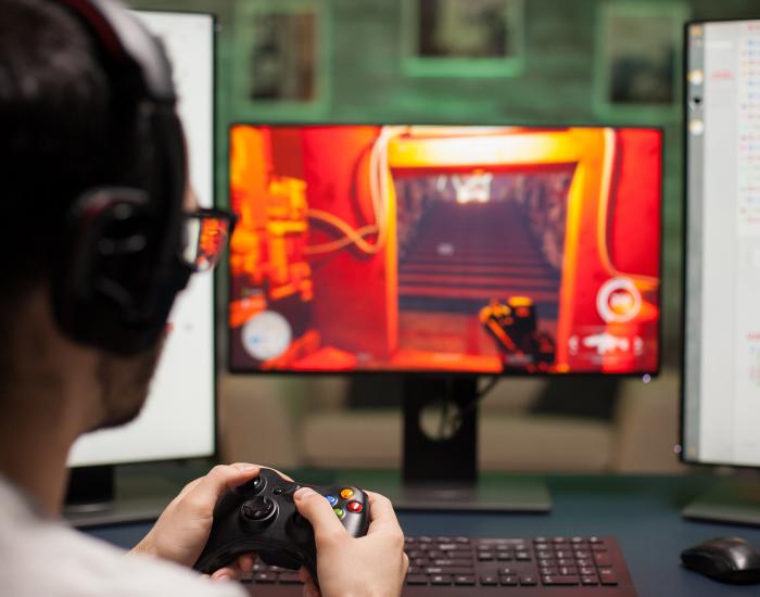 close-up-of-man-using-joystick-while-playing-shoot-EQWWUT3-6