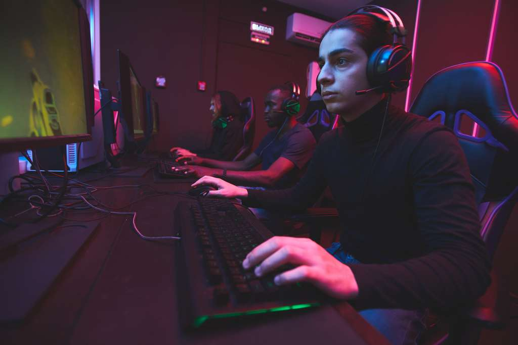 e-sports-gamers-playing-online-game-via-network-C8WR5QL
